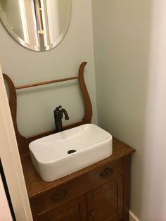 We made the vanity in the half bath from an antique wash stand. Vintage Bathroom Sinks, Bathroom Sink Units, Small Basement Bathroom, Best Bathroom Vanities, Downstairs Bathroom, Bathroom Ideas, Quirky Bathroom, Primitive Bathrooms, Rustic Bathrooms