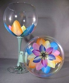 Price is for a set of two. Look into the glass and you will see a colorful open flower.Each glass hand painted and signed. These are 19 oz Ballon Red Wine glasses. The stem is painted green to give the effect of flowers decorating your table Wine Glass Crafts, Wine Craft, Wine Bottle Crafts, Bottle Art, Wine Bottles, Wine Decanter, Diy Wine Glasses, Decorated Wine Glasses, Hand Painted Wine Glasses