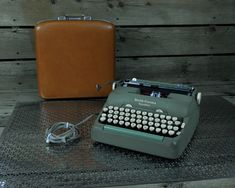 Vintage Green Typewriter, 1950s Retro, Smith Corona 5TE, Portable Electric, Rare Model, Carrying Case, Mint w White, Metal Body, Home Decor by VintageDecorAddict on Etsy Smith Corona Typewriter, Retro Typewriter, Portable Typewriter, Vintage Shelf, Vintage Baskets, Vintage Storage, Vintage Home Decor, Atomic Decor, Purses