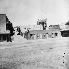 """The """"crib district"""" of Chinatown where bordellos flourished. This photo looks west from Alameda Street towards the Plaza. Part of the two-storied Lugo Adobe (razed in 1951) can be seen on the far right hand side (in the distance) just above the building with the porch overhang. Picture was taken in 1891. (LAPL) Bizarre Los Angeles"""