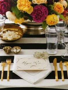 glamorous place setting. <3 the contrast of the flowers + black and white striped tablecloth + pop of bright flowers