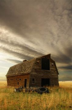 An abandoned barn leans precariously near collapse in Southern Alberta. Photo by Darby Sawchuk