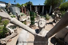 Photos and pictures of: The Camel Yard with concrete sculptures surrounding The Owl House, Nieu Bethesda, Eastern Cape, South Africa - The Africa Image Library Concrete Sculpture, Sculpture Art, Sculptures, Installation Architecture, South African Art, Africa Art, Owl House, Outsider Art, Heritage Site