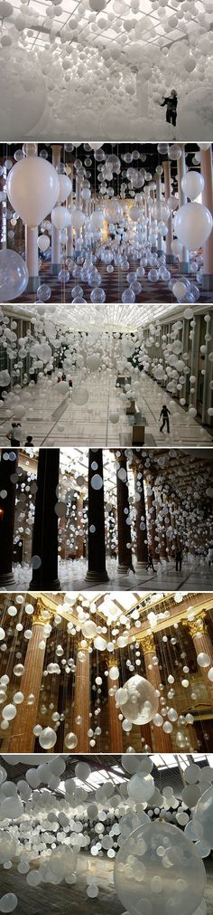 "Balloon art installation by William Forsythe: Scattered Crowds (2012). Thousands of white balloons are suspended in the air, accompanied by a wash of music, emphasising ""the air-borne landscape of relationships, distance, of humans and emptiness, of coalescence and decision""."