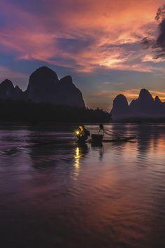 Lijiang fishing boat - by: Asia Net Ray
