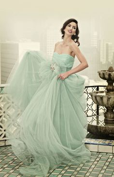 Tulle strapless Ball Gown. Soft Turquoise. Shown with custom made jeweled brooch and tulle tie.