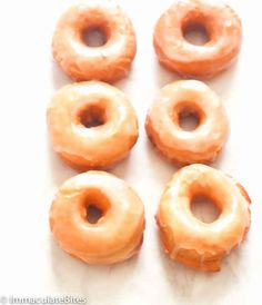 Krispy Kreme Doughnut Recipe(Copy Cat) -- Light and fluffy donuts topped with a rich glaze on top that will melt in your mouth. Tastes as good as the store-bought Krispy Kremes! Krispy Creme Donut Recipe, Crispy Cream Donuts Recipe, Cream Donut Recipe, Easy Donut Recipe, Donut Recipes, Dessert Recipes, Cooking Recipes, Krispy Kreme Icing Recipe, Muffin Recipes