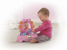 Playtime gets a pretty makeover with the Fisher-Price® Laugh & Learn™ Magical Musical Mirror! Baby's very own lighted vanity mirror is perfect for glam sessions filled with learning and fun with...