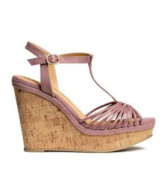 Sandals in imitation suede. Cork wedge heel, ankle strap with metal buckle, and rubber soles. Platform front height 1 1/2 in., heel height 4 3/4 in.
