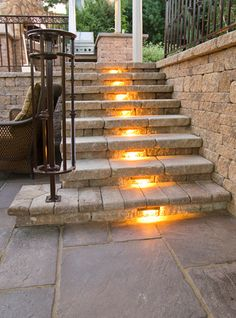 Large Outdoor Living Area with Separate Spaces. Traditional patio style with lighted stairs!