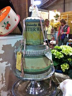 wedding cake made from vintage tins & baking pans. Cute idea for a bridal shower centerpiece. Seen at 2011 Farm Chicks show.