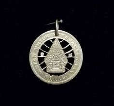 Indonesian cut coin pendant silver color already found the sale at:  https://www.etsy.com/au/shop/ChronicSmithing?ref=search_shop_redirect