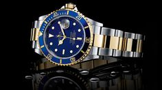 Rolex Submariner, blue face, gold and stainless steel oyster bracelet.