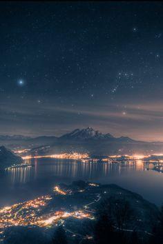 Starry sky sky night city lights water stars reflection