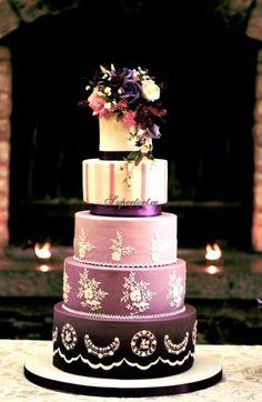 Purple cake and royal icing lace wedding cake
