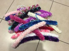 Knitted coat hangers 70 stitches 18 rows feather or flurry wool 4mm needles