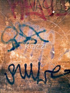 grunge graffiti wall from rome - A heavily graffitied wall.