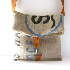 This tote folds over to keep all your belongings safe inside! Useful, stylish, and totally adorable.    The bag is constructed from an original print recycled coffee bean burlap sack. Lined with a striped canvas and closes with a metal clip and d-ring closure on an orange wool strap.    Measurements are as follows:    width = 12.5 inches    height = 13 inches when closes, 18 inches when open    strap = ADJUSTABLE! adjusts between 22 and 38 to be worn on the shoulder or across the body. This…