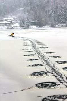 Winter kayaking through ice looks really 'cool' just don't fall in!