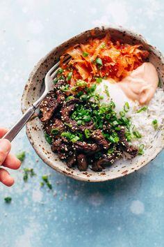 Korean BBQ Yum Yum Rice Bowls: easy marinated steak, spicy kimchi, poached egg, rice, and yum yum  sauce! | pinchofyum.com (beef)