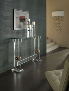 A contemporary console table designed in glass giving a luxurious touch to this modern entryway.