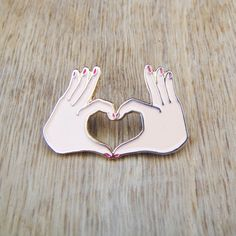 ***FINALLY BACK IN STOCK!! *** Made of shiny gold brass, light pink and red enamels, and 2 butterfly claps. This pin measures 3 x 2 cm. The