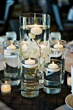 Floating candles, add some flowers, a bit of colour.....statement