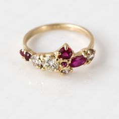 This ruby and champagne diamond ring is the only one of its kind, with a cluster of sparkling gems carefully chosen and hand-set in 14k yellow gold by Melanie here in our studio. This ring features e