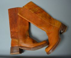 Incredible 1970s leather knee highs! Done in a distressed whiskey and honey tanned leather. Leather sole,s stacked wooden heel. The ultimate