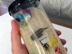 I spy tube toy! neat idea with small toys rice and a tennis ball tube. Gotta play more tennis... lol