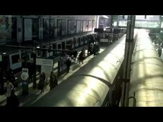 Somthings never change. Earl's Court Station London 2013 - YouTube. See the background for traveller running between platforms.