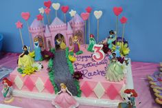 Disney princess cake. We started with a sheet cake. We provided the bakery with Disney princess figurines and the castle (purchased on Amazon.com) They created a garden setting. They made a cobblestone trail from the castle with fondant and used fresh flowers around the princesses. They added star and heart wands and a checkered border. Our daughter loved it!