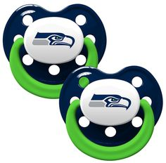 """Soothe your little fan with officially licensed pacifiers. These orthodontic pacifiers feature a silicone nipple with a plastic shield and grasping hook. The team logo is adorned on the """"button"""" with"""