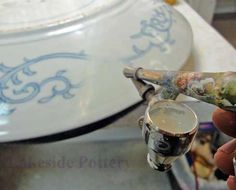 Painting Repaired China and Sculpture   Cearmic Restoration Service