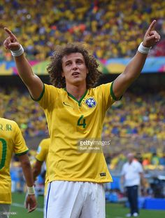 David Luiz of Brazil celebrates scoring his team's first goal during the 2014 FIFA World Cup Brazil round of 16 match between Brazil and Chile at Estadio Mineirao on June 28, 2014 in Belo Horizonte, Brazil.