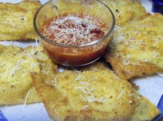 Toasted Ravioli from Food.com:   These Italian appetizers are crunchy and delicious dipped in a warm marinara sauce. They are very addictive! Make a bunch, you'll need to have a lot!