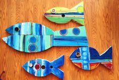 Set of 4 handmade wooden fish.