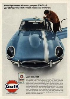 """An original 1967 advertisement for Gulf Oil. Featuring a blue Jaguar XK-E coupe car. A man detailing white race stripes trim. """"Even if you went all out to get y"""