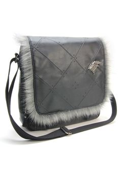 02ca271188e This is a Game of Thrones House Stark Messenger Bag with faux fur