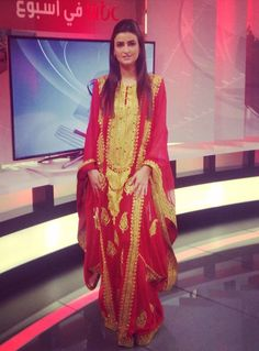 Traditional Arabic dress worn by a TV presenter. Red with gold emboidery.  This style 61b1dc47e