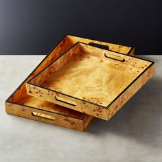 Shop Burl Wood Trays. Deco servers covered in a layer of glossy burl wood veneer––a high-end material made popular in the 1920s. Usually waaaay more expensive, we found a way to source it for less.