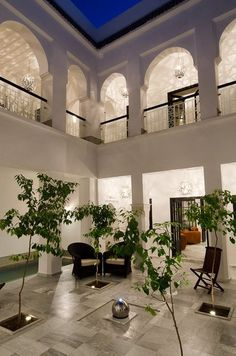 Beautiful night view of the courtyard in the middle of a riad in Marrakech. Perfect for a luxury villa in Morocco.