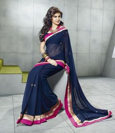 Navy blue coloured Georgette #saree with a pink, gold and copper border. #IndianWear #Sari