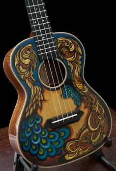 Acoustic guitar with peacock inspired paint job.- Acoustic guitar with peacock inspired paint job. Acoustic guitar with peacock inspired paint job. Acoustic Guitar Chords, Ukulele Art, Ukelele, Guitar Songs, Music Painting, Guitar Painting, Music Artwork, Guitar Drawing, Painting Canvas