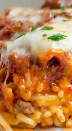 Baked Million Dollar Spaghetti ~ Creamy with a melty cheese center, topped with meat sauce and extra bubbly cheese. Tastes like a cross between baked ziti and lasagna with half the effort! Casserole Spaghetti, Spaghetti Dinner, Spaghetti Squash, Baked Spaghetti, Best Pasta Recipes, Beef Recipes, Dinner Recipes, Cooking Recipes, Delicious Recipes