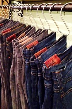 save a ton of space in your bedroom closet by using s-shaped hooks to hang pants and other items.