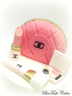 Pink, white & gold CHANEL cosmetics cake
