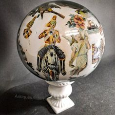 This wonderful piece is full of Victoriana. A good glass dome with period imagery including , cavalrymen, lighthouses and fairies sits on a substantial ceramic foot. The piece is in good condition with only age related wear. Victorian, glass, British. Antiques Atlas Antique Glass, Glass Domes, Lighthouses, Fairies, Period, British, Victorian, Ceramics, Age