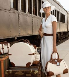 This is entirely all perfect to the luggage and her hat and her dress....Love it...ee..