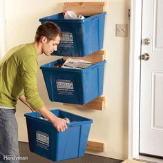 Recycling bins tend to take up way too much floor space. Here's an easy project that will get them up off the floor and out of the way, and it costs almost nothing. Find simple DIY instructions to build this project for your garage here.